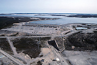 Quebec, Canada, February 1980.   The James Bay Project, a series of hydroelectric power stations on the La Grande River in northwestern Quebec, Canada, built by the state-owned utility Hydro-Quebec.  The project covers an area of the size of the State of New York and is one of the largest hydroelectric systems in the world, with a generating capacity of 16,527 megawatts. - Aerial view on the James Bay and the power plants construction site.