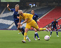 Women's Olympic Football match France v Sweden on 3.8.12...Marie Hammarstrom of Sweden and Corine Franco (left) and Elise Bussaglia of France, during the Women's Olympic Football match between France v Sweden at Hampden Park, Glasgow...............