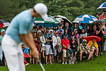 CROMWELL, CT. 20 June 2019-062019 - Spectators all ready for the inclement weather watch PGA Tour player Jordan Speith putt for birdie on the fourth hole, during the first round of the Travelers Championship at TPC River Highlands in Cromwell on Thursday. Bill Shettle Republican-American