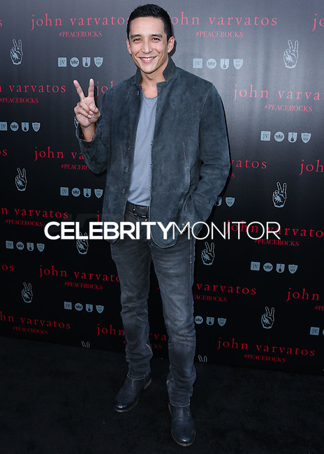 WEST HOLLYWOOD, CA, USA - SEPTEMBER 21: Gabriel Luna arrives at the John Varvatos #PeaceRocks Ringo Starr Private Concert held at the John Varvatos Boutique on September 21, 2014 in West Hollywood, California, United States. (Photo by Xavier Collin/Celebrity Monitor)