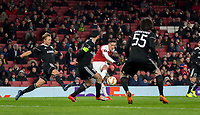 Mesut Ozil of Arsenal hits a shot at goal during the UEFA Europa League match between Arsenal and Qarabag FK at the Emirates Stadium, London, England on 13 December 2018. Photo by Andy Rowland.