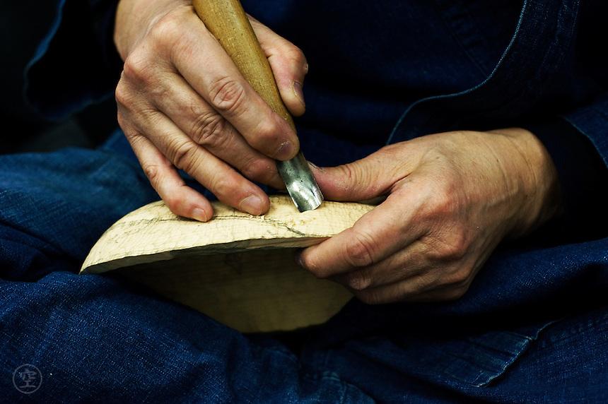 Carving detail: Kitagawara Seiun and female mask.