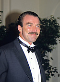 Actor Tom Selleck arrives at the White House for the Official Dinner honoring Prime Minister Margaret Thatcher of Great Britain in Washington, DC on November 16, 1988.<br /> Credit: Ron Sachs / CNP