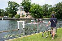 "Henley on Thames, United Kingdom, 23rd June 2018, Saturday,   ""Henley Women's Regatta"",  view, Coach, sitting, watching, his crew, in their Heat, as they pass the ""Temple Folly"", on. ""Temple Island"", Henley Reach, River Thames, Thames Valley,  England, © Peter SPURRIER/Alamy Live News"