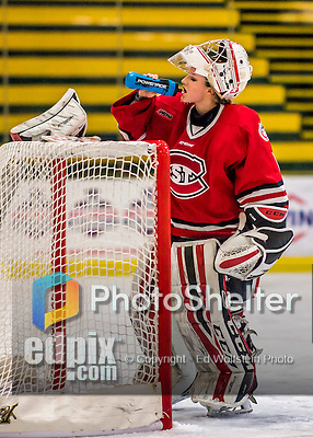 25 November 2016: Saint Cloud State Huskie Goaltender Janine Alder, a Freshman from Zurich, Switzerland, hydrates in the second period of a game against the University of Vermont Catamounts at Gutterson Fieldhouse in Burlington, Vermont. The Lady Cats defeated the Huskies 5-1 to take the first game of the 2016 Windjammer Classic Tournament. Mandatory Credit: Ed Wolfstein Photo *** RAW (NEF) Image File Available ***