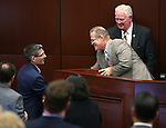 Republican Rep. Joe Heck talks Lt. Gov. Mark Hutchison and Assembly Speaker John Hambrick following his address to a joint session at the Legislative Building in Carson City, Nev., on Monday, March 30, 2015. <br /> Photo by Cathleen Allison