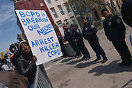 Baltimore, MD - April 25, 2015: Tarsha Gramf, left, gathered with hundreds of protestors near the Baltimore Police Department's Western District Headquarters, April 25, 2015, to demand police accountability in the death of Freddie Gray and protest police brutality. Gray died of a broken spine while in police custody.  (Photo by Don Baxter/Media Images International)