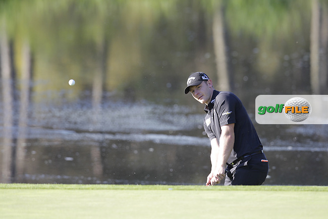 Scott Henry (SCO) chips onto the 4th green during Thursday's Round 1 of the 2014 Open de Espana held at the PGA Catalunya Resort, Girona, Spain. Wednesday 15th May 2014.<br /> Picture: Eoin Clarke www.golffile.ie