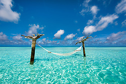 A relaxing escape... this hammock stands on a small sandbar in the lagoon waters of the Indian Ocean.