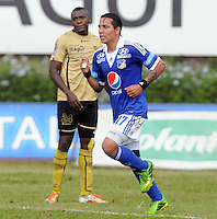 MEDELLIN-COLOMBIA- 29 -09-2013.  Dayro Moreno jugador de Los Millonarios celebra su gol contra el Itagui , partido correspondiente a la doceava fecha de La Liga Postobon segundo semestre jugado en el estadio de Ditaires  /Dayro Moreno Los Millonarios player celebrates his goal against Itagui the twelfth game in La Liga Postobon date second half played in the stadium of Ditaires.Photo: VizzorImage /Luis Rios / Stringer