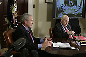 Washington, D.C. - July 13, 2007 -- United States President George W. Bush  participates in a video teleconference with Iraq Provincial Reconstruction Team Leaders, Embedded Provincial Reconstruction Team Leaders, and Brigade Combat Commanders, from the Roosevelt Room of the White House on Friday, July 13, 2007.  US Vice President Dick Cheney is seated at right.<br /> Credit: Evan F. Sisley - Pool via CNP