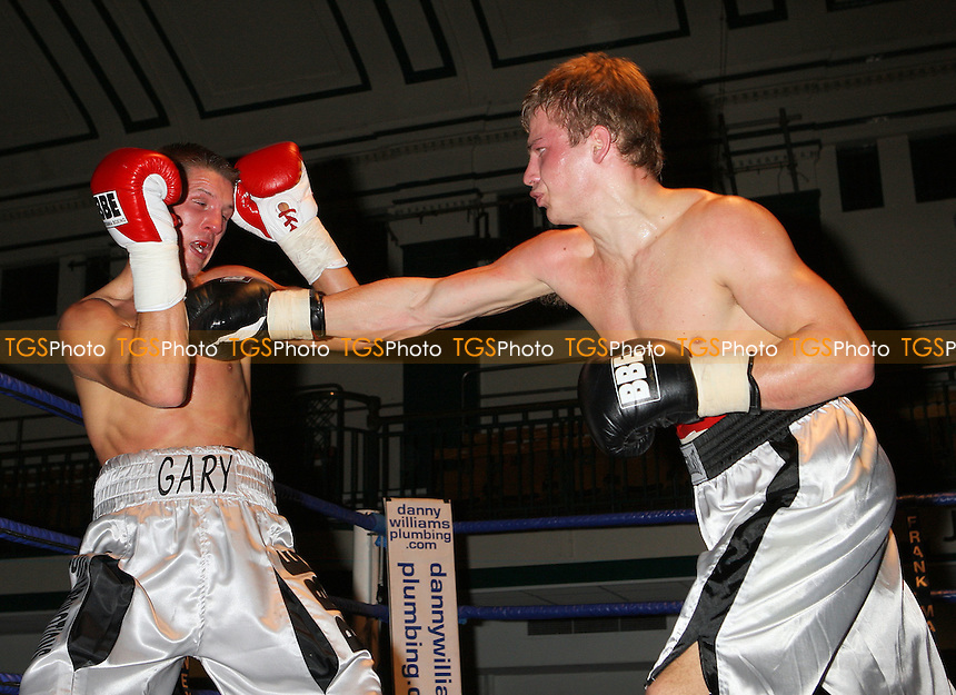 Gary Woolcombe (Bexleyheath, silver shorts) defeats Janis Chernouskis (Tukums, white shorts) in a Light-Middleweight boxing contest at York Hall Bethnal Green, promoted by Frank Maloney / FTM Sports - 15/11/08 - MANDATORY CREDIT: Gavin Ellis/TGSPHOTO - Self billing applies where appropriate - 0845 094 6026 - contact@tgsphoto.co.uk - NO UNPAID USE.