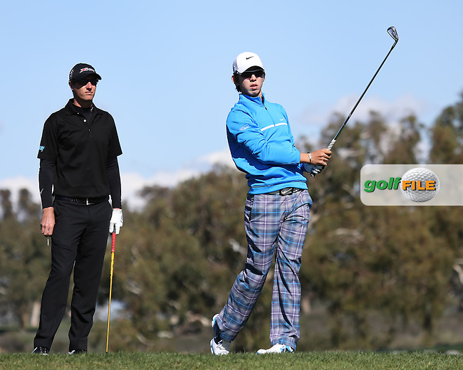 28 JAN 13  Belgian Nicolas Colsaerts looks on as Seung Yul Noh hits his drive off the 2nd tee during Mondays Final Round at The Farmers Insurance Open at Torrey Pines Golf Course in La Jolla, California. (photo:  kenneth e.dennis / kendennisphoto.com)
