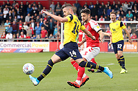 Oxford United's Anthony Forde under pressure from Fleetwood Town's Danny Andrew<br /> <br /> Photographer Rich Linley/CameraSport<br /> <br /> The EFL Sky Bet League One - Fleetwood Town v Oxford United - Saturday 7th September 2019 - Highbury Stadium - Fleetwood<br /> <br /> World Copyright © 2019 CameraSport. All rights reserved. 43 Linden Ave. Countesthorpe. Leicester. England. LE8 5PG - Tel: +44 (0) 116 277 4147 - admin@camerasport.com - www.camerasport.com