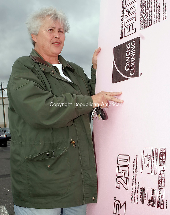 WATERBURY, CT26 October 2005-102605TK02  Judy Anderson of Naugatuck invest in cold weather insulating sheeting for a home storage area. Tom Kabelka / Republican-American (Judy Anderson)CQ
