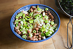 Close up looking down close up fresh mixed bean and chopped spring onion salad in bowl