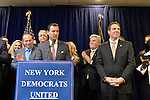 Albertson, New York, U.S. 26th October 2013. New York Governor ANDREW CUOMO, front right, endorses TOM SUOZZI, at podium, for Nassau County Executive, at the Albertson Veterans of Foreign Wars VFW Post. Democrat Suozzi, the former Nassau County Executive, and Republican incumbent Mangano face each other in a rematch in the upcoming November 5th election.