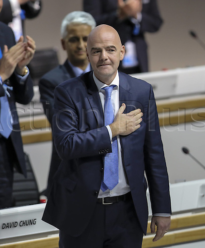 26.02.2016. Zurich, Switzerland. Swiss Gianni Infantino (front) salutes the audience after he was elected FIFA president in the second round of voting at the Extraordinary FIFA Congress 2016 at the Hallenstadion in Zurich, Switzerland, 26 February 2016. The Extraordinary FIFA Congress was held in order to vote on the proposals for amendments to the FIFA Statutes and choose the new FIFA President.