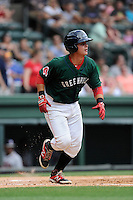 Catcher David Sopilka (12) of the Greenville Drive bats in a game against the Rome Braves on Sunday, June 14, 2015, at Fluor Field at the West End in Greenville, South Carolina. (Tom Priddy/Four Seam Images)