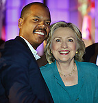 FORT LAUDERDALE,  FL - JULY 31: Democratic Presidential hopeful former Secretary of State Hillary Rodham Clinton (R) and Oscar Joyner pose for picture during the Presidential Candidates Plenary at the National Urban League Conference at Broward County Convention Center on Friday July 31, 2015 in Fort Lauderdale, Florida ( Photo by Johnny Louis / jlnphotography.com )