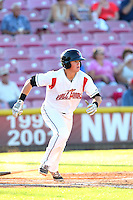 Christian Arroyo #15 of the Salem-Keizer Volcanoes bats against the Eugene Emeralds at Volcanoes Stadium on July 27, 2014 in Keizer, Oregon. Salem-Keizer defeated Eugene, 9-1. (Larry Goren/Four Seam Images)