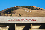 we are montana slogan on grizzly football stadium in missoula, montana with the M and mount sentinel in background