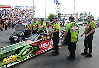 Aug. 7, 2011; Kent, WA, USA; NHRA top fuel dragster crew members for driver Terry McMillen during the Northwest Nationals at Pacific Raceways. Mandatory Credit: Mark J. Rebilas-