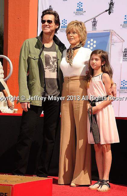 HOLLYWOOD, CA- APRIL 27: Actors Actors Jim Carrey, Jane Fonda and granddaughter Viva Vadim attend actress Jane Fonda's Handprint/Footprint Ceremony during the 2013 TCM Classic Film Festival at TCL Chinese Theatre on April 27, 2013 in Los Angeles, California.