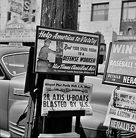 Word on the Street: Newsstand on a street corner in Los Angeles, California. April 1942.<br /> <br /> Photo by Russell Lee