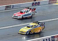 Apr. 7, 2013; Las Vegas, NV, USA: NHRA funny car driver Matt Hagan (near) races Bob Tasca III during the Summitracing.com Nationals at the Strip at Las Vegas Motor Speedway. Mandatory Credit: Mark J. Rebilas-