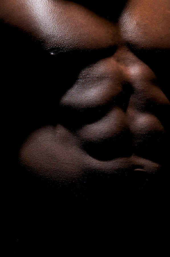 Close up of a worked abdominal of an African American Young.