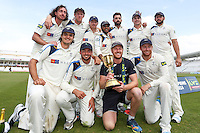 Picture by Alex Whitehead/SWpix.com - 12/09/2014 - Cricket - LV County Championship Div One - Nottinghamshire CCC v Yorkshire CCC, Day 4 - Trent Bridge, Nottingham, England - Yorkshire team celebrate with the trophy.