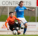 St Johnstone's Steven May brings down Dundee Utd's Ryan Dow.