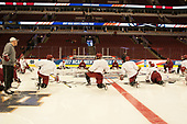The Crimson stretched at center ice. - The Harvard University Crimson practiced at the United Center on Wednesday, April 5, 2017, in Chicago, Illinois.