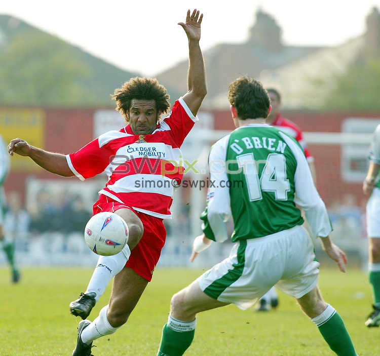 Pix, Shaun Flannery/SWpix. Nationwide Conference..Doncaster Rovers v Yeovil, 12/4/2003..COPYRIGHT PICTURE>>SIMON WILKINSON>>01943 - 436649>>..Doncaster's Don Goodman beats Yeovil's Roy O' Brien.
