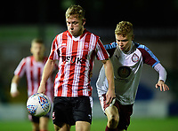 Lincoln City U18's Jon Smith vies for possession with South Shieldsy U18's Josh Elcoate<br /> <br /> Photographer Chris Vaughan/CameraSport<br /> <br /> The FA Youth Cup Second Round - Lincoln City U18 v South Shields U18 - Tuesday 13th November 2018 - Sincil Bank - Lincoln<br />  <br /> World Copyright © 2018 CameraSport. All rights reserved. 43 Linden Ave. Countesthorpe. Leicester. England. LE8 5PG - Tel: +44 (0) 116 277 4147 - admin@camerasport.com - www.camerasport.com