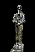 Ancient Egyptian statue of the god Ptah, granodiorite, New Kingdom, 18th Dynasty, (1390-1353 BC)Karnak. Egyptian Museum, Turin. black background,<br /> <br /> The statue of the god Ptah is in the likeness of the reigning king Amenhotep III with a youthful almost feminine face, full cheeks, large smiling mouth and fleshy lips. The large almond shaped eyes are characteristic of the period as is the outline of the lips, Drovetti collection. Cat 86