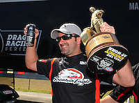 Mar. 12, 2012; Gainesville, FL, USA; NHRA pro stock motorcycle rider Eddie Krawiec celebrates after winning the Gatornationals at Auto Plus Raceway at Gainesville. The race is being completed on Monday after rain on Sunday. Mandatory Credit: Mark J. Rebilas-