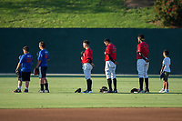 A trio of young baseball players join Kannapolis Intimidators outfielders Tyler Sullivan (2), Joel Booker (23), and Micker Adolfo (27) on the field for the National Anthem prior to the game against the Hagerstown Suns at Kannapolis Intimidators Stadium on June 15, 2017 in Kannapolis, North Carolina.  The Intimidators defeated the Suns 9-1 in game two of a double-header.  (Brian Westerholt/Four Seam Images)