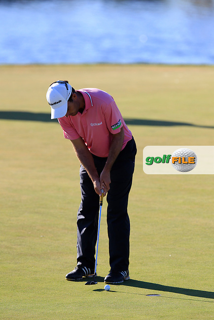Edoardo Molinari (ITA) putts on the 14th green during Friday's Round 2 of the Portugal Masters at the Oceanico Victoria Golf Course, Vilamoura, Portugal 12th October 2012 (Photo Eoin Clarke/www.golffile.ie)