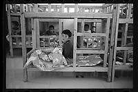 Jeminay County, Xinjiang Uygur Autonomous Region, China - Students take an afternoon nap at a nursery, October 2019.