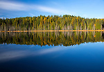 Idaho, Northern, Bonners Ferry. Dawon Lake shoreline and reflections in autumn.