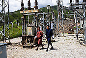 Dorji from the Bhutan Power Corp. walks with his and his manager walks through the power station in Thimphu, Bhutan. Photo: Sanjit Das/Panos