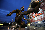 7th December 2017, Emirates Stadium, London, England; UEFA Europa League football, Arsenal versus BATE Borisov; Statue of Arsenal legend Dennis Bergkamp outside the Emirates Stadium as the sun is setting