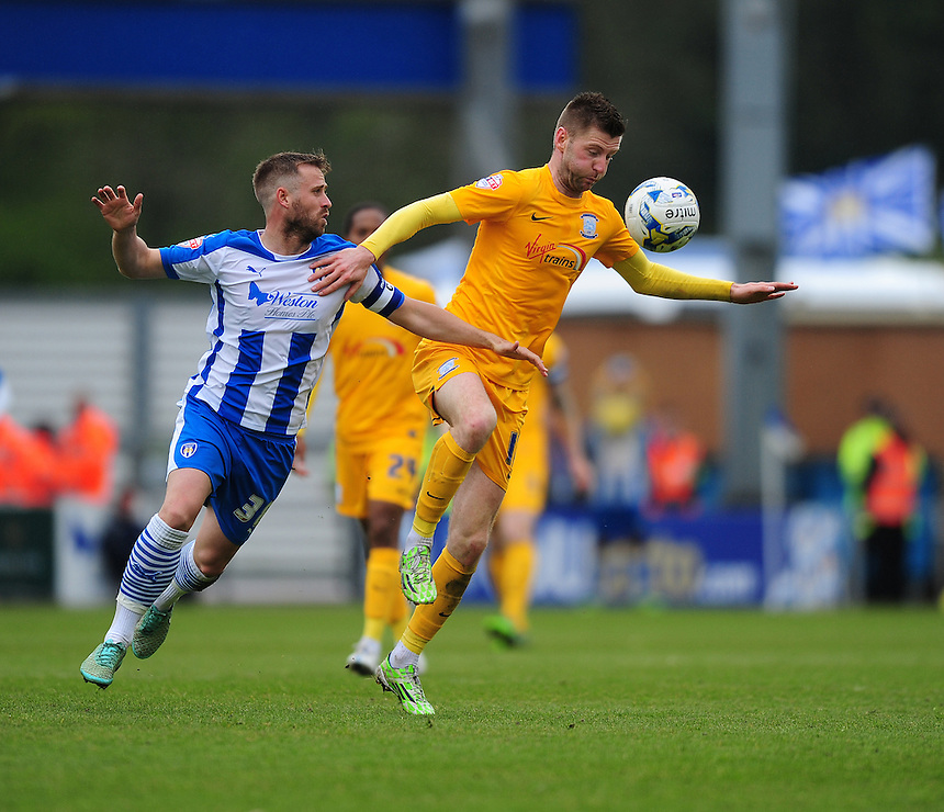 Preston North End's Paul Gallagher shields the ball from Colchester United's David Fox<br /> <br /> Photographer Chris Vaughan/CameraSport<br /> <br /> Football - The Football League Sky Bet League One - Colchester United v Preston North End - Sunday 3rd May 2015 - Weston Homes Community Stadium - Colchester<br /> <br /> &copy; CameraSport - 43 Linden Ave. Countesthorpe. Leicester. England. LE8 5PG - Tel: +44 (0) 116 277 4147 - admin@camerasport.com - www.camerasport.com