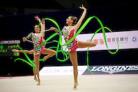Italian rhythmic group turns slow pirouettes during 5-ribbons routine at 2006 Mie World Cup Finale of rhythmic gymnastics on November 17, 2006 at Mie, Japan.<br />