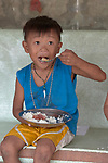 A boy eats a meal in a preschool sponsored by the Kapatiran-Kaunlaran Foundation (KKFI) in Pulilan, a village in Bulacan, Philippines.<br /> <br /> KKFI is supported by United Methodist Women.