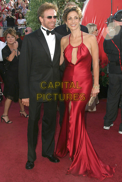 JERRY BRUCKHEIMER & MELNDA KANAKAREDES.56th Annual Prime Time Emmy Awards held at the Shrine Auditorium. .September 19th, 2004.full length, red silk, satin dress, halterneck, plunging neckline, tuxedo, clutch purse, sunglasses, shades.www.capitalpictures.com.sales@capitalpictures.com.©Don Shaffer/AdMedia/Capital Pictures.