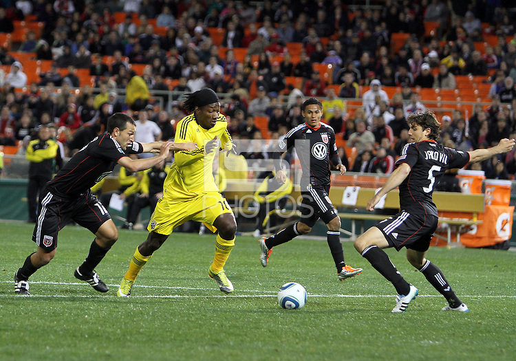 Jed Zayner#12 and Dejan Jakevic#5 of D.C. United close in on Andres Mendoza#10 of the Columbus Crew during the opening match of the 2011 season at RFK Stadium, in Washington D.C. on March 19 2011.D.C. United won 3-1.