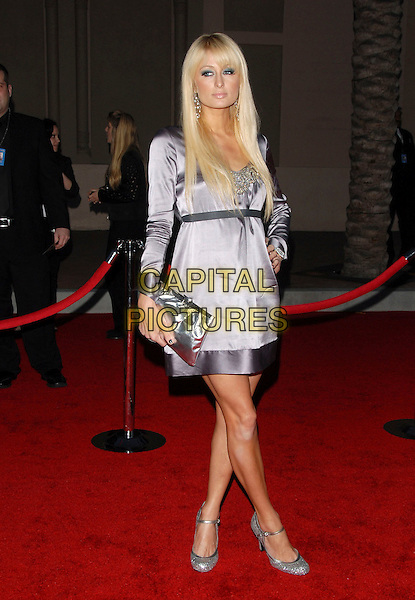 PARIS HILTON.The 34th Annual American Music Awards held at The Shrine Auditorium in Los Angeles, California, USA. - Arrivals.November 21st, 2006.full length silver grey gray dress clutch purse bag mary janes shoes.CAP/DVS.©Debbie VanStory/Capital Pictures